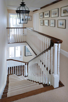 Staircase designed in conjunction with Adam Architecture with hand carved handrails