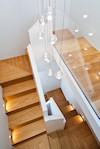 Archchitecs :- Studio Azzurro Architects, London. House in Chelsea, full refurbishment including this very contemporary modern staircase that could be turned up side down and still be used as a staircase. Oak treads and risers quartered on the landings, painted with glass balustrade.