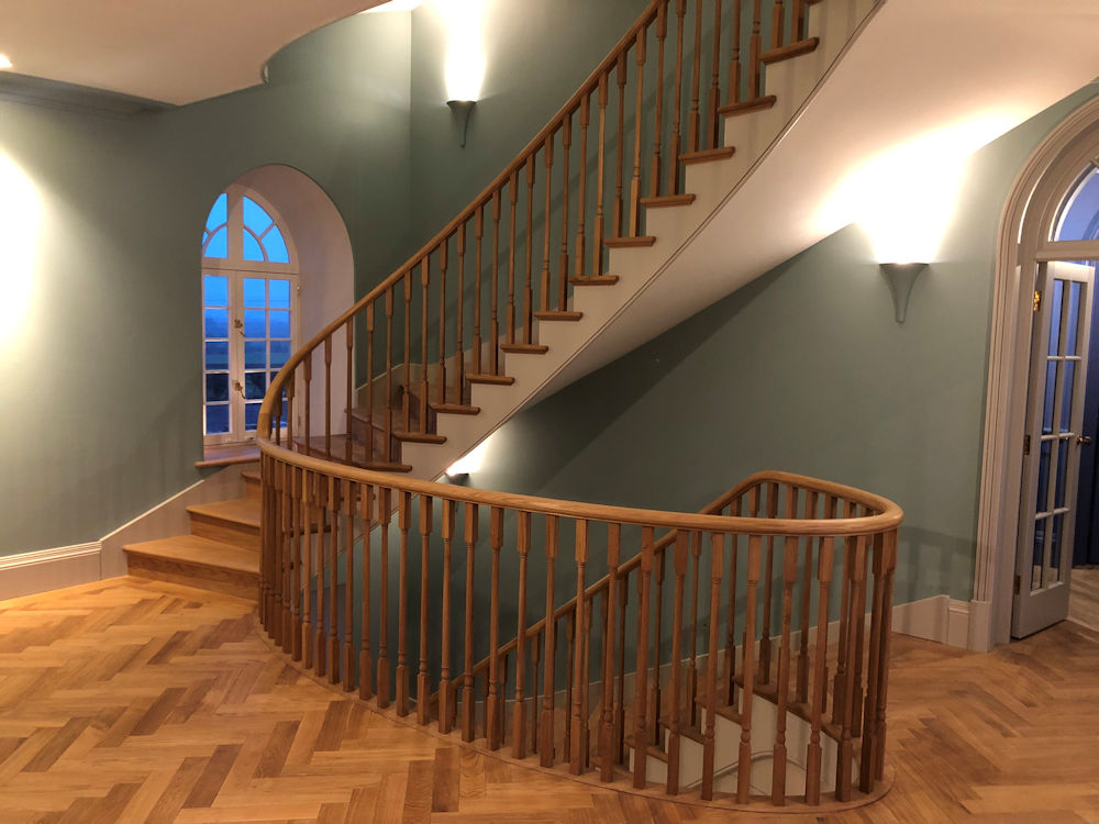 a graceful solution to a problematic stairwell passing through 3 three floors in a listed country house