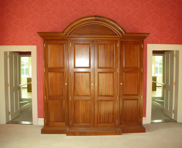 Wardrobes Design by Robert Adam Architects to suit a grand house of classical proportions in Utile with french polish. Note how this fits with size and proportions of the room