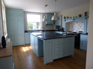 Adam Architecture designed kitchen and breakfast room painted in a stunning dark duck egg blue set off with slate tops.