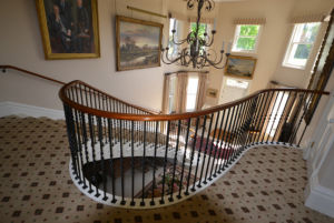 Cut string helix staircase with metal balustrade